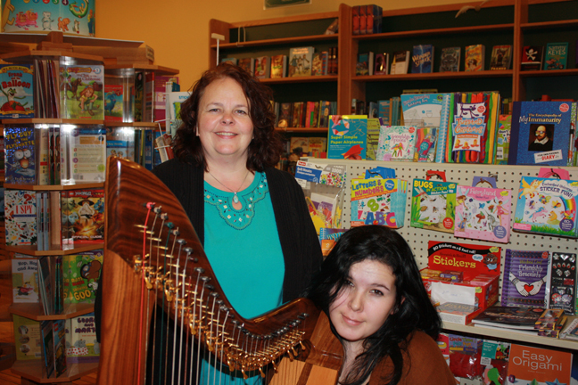 Deb Lloyd of Angelic Blessings and Lauren Ashley Playing Beautiful Harp Music photo